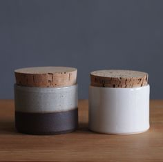 pair of corked canisters brown and white (0108)