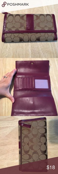 Coach wallet. Dark purple trim Coach wallet . Patent leather dark purple trim. Good used condition . Great wallet with tons of space . Coach Bags Wallets