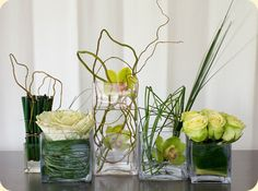 set of 5 varying size square vases each with it's own unique arrangement. Modern Floral Arrangements, Table Arrangements, Flower Arrangements, Green Centerpieces, Centerpiece Ideas, Ornamental Kale, Corporate Flowers, Cymbidium Orchids, Plant Pictures