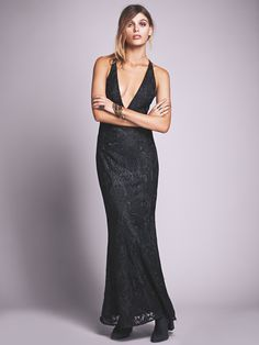 Juliet Bodycon   Lace maxi dress with deep V-neckline and low, strappy back. Fits tight to the body. Side zip for easy fit. Fully lined.