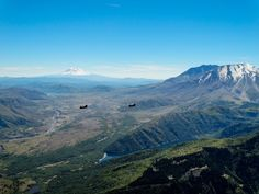 Mt St Helens & Mt Adams Washington USA with a pair of Chinooks [OC] [5184x3888]