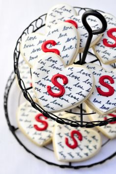 Black, white and red heart cookies with love script.