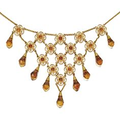 18 KARAT GOLD AND CITRINE NECKLACE, TIFFANY & CO., DESIGNED BY LOUIS COMFORT TIFFANY, CIRCA 1910.  Composed of a flexible lattice of gold quatrefoils, each centering a round citrine, supporting a fringe of 9 briolette citrine drops, length 16½ inches, signed Tiffany & Co.