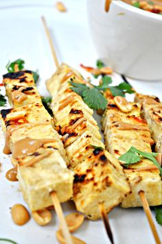 Tofu marinated in coconut milk and green curry paste, these vegan skewers are grilled to perfection and dipped in spicy peanut sauce! Vegan Thai Green Curry, Tofu Curry, Vegetarian Recipes, Cooking Recipes, Tofu Recipes, Vegetable Skewers, Spicy Peanut Sauce, Vegan Dishes, Wolves