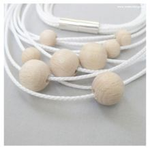 Necklace EARLY ORBIT #1 by www.matterdesign.de in ice-white with wooden beads and magnetic clasp, total length 58 cm