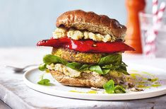 Need some veggie burger inspiration for your barbecue? Try this veg-packed halloumi burger recipe for an easy win. See more barbecue recipes at Tesco Real Food. Best Veggie Burger, Chickpea Burger, Vegetarian Burgers, Burger Recipes, Veggie Recipes, Vegetarian Recipes, Healthy Recipes, Healthy Dinners, Yummy Recipes