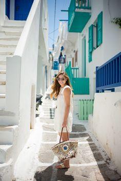 Julia Engel of Gal Meets Glam in her metallic JOIE Nice Sandals while in Mykonos