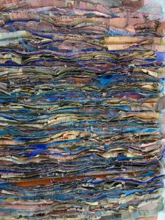 Layers of newspaper and polyester organza stitched together and slashed and distressed to create faux chenille.   One of the things we d...