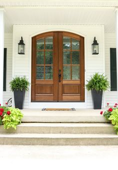 There's something special about a statement front door that sets the tone for your whole house. We decided to go with a solid wood top arched door to really transform the outside of our home. Sharing more and some original pictures. Arched Front Door, Double Front Entry Doors, Double Doors Exterior, Front Door Entrance, Arched Doors, House Front Door, Solid Wood Front Doors, Stained Front Door, Front Door Lighting
