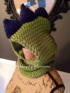 You're going to love Cozy Dino Hooded Cowl Loom Knit Pattern by designer Chewy Tart. Loom Crochet, Loom Knit Hat, Knit Or Crochet, Crochet Scarves, Crochet Crafts, Yarn Crafts, Crochet Things, Loom Knitting Projects, Loom Knitting Patterns