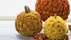 Pumpkins Decorated with Chrysanthemums Fall favorites -- chrysanthemums and pumpkins -- come together for a dazzling decorating idea perfect for autumn parties.