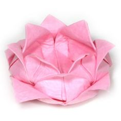 floating origami lotus flowers in a the small pond that is going to be at the venue.