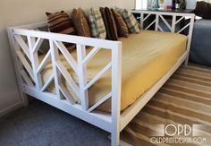 daybed cost around $50- $75 to make. full plan! Lily seems to sleep on her bed sideways... this might be perfect for her!
