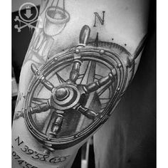 Amazing black and grey ship's wheel tattoo with coordinates by Kevin Soto.  #12ozstudios #team12oz #tattoos #tattooartist #nautical #shipwheel #coordinates #tattoosformen #tattoosforwomen #blackandgrey #realism
