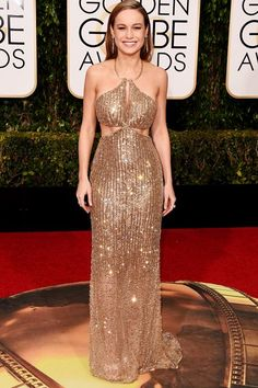 The Boldest Looks From This Year's Golden Globes Red Carpet #refinery29  http://www.refinery29.uk/2016/01/100855/golden-globes-2016-red-carpet-best-dressed#slide-12  Brie Larson - You can always trust that someone's going to take the Golden Globes theme to heart, and Brie Larson's custom Calvin Klein dress looks like it's literally made with millions of tiny, golden stars. The delicate halter leads to an impressive side cutout that reveals Larson's most extraordinary accessory: her abs...