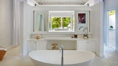 Sink into this luxurious tub in your Beachfront Colonial-style Villa Sugar Beach, A Viceroy Hotel in St.