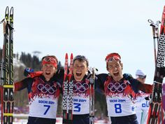 Sochi 2014 Day 17 - Cross Country Men's 50 km Mass Start Free Silver medalist Maxim Vylegzhanin of Russia, gold medalist Alexander Legkov of Russia and bronze medalist Ilia Chernousov of Russia celebrate after the Men's 50 km Mass Start Free