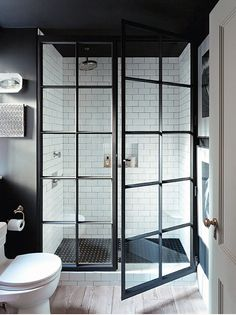 black white bathroom with industrial shower doors