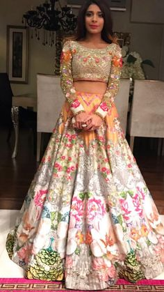 Light Lehengas - Floral Offbeat White and Gold Lehenga | WedMeGood | Embroidered and Embellished Blouse with Orange and White Floral Print #wedmegood #indianbride #indianwedding #lehenga #floral #printed