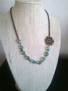 Vintage Crystal and Gold Lace Charm Necklace-light blue by TheKOJewelry. $25.00, via Etsy.