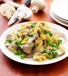 Turkey Tetrazzini  1 teaspoon olive oil  10 ounces white mushrooms, sliced  1 small onion, chopped  1/2 teaspoon salt  1/2 teaspoon black pepper  2 tablespoons flour  6 ounces egg noodles  1 can (14.5 ounces) low-sodium chicken broth  3/4 cup light cream  1 package cooked turkey breast strips (such as Purdue Short Cuts)  1 package (10 ounces) frozen peas, thawed