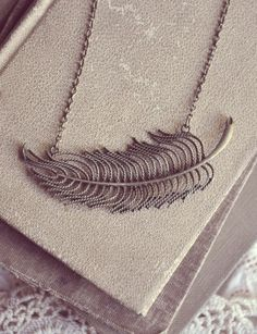 floating feather necklace.