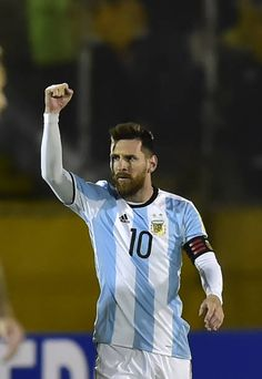 Argentina's Lionel Messi celebrates after scoring against Ecuador during their 2018 World Cup qualifier football match in Quito on October 10 2017 /...