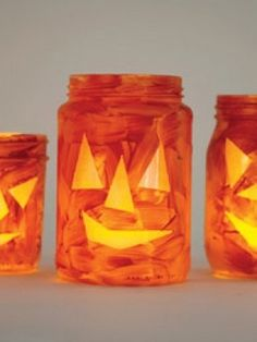 take a jar, paint it orange then cut out the eyes, nose, and mouth from yellow paper. then you stick them on and let dry for at least 1 hour.