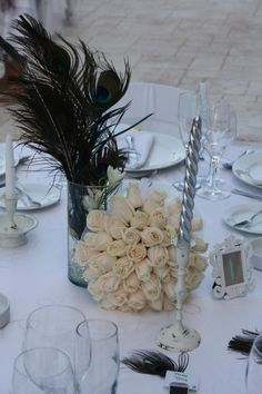 Peacock Feather Centerpiece. Follow more of this trend at http://www.arizonaweddings.com/
