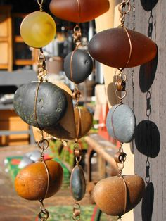 Rain Chains: Since copper is being stolen all over the country, this gives a good alternative method. I would use lovely colored pieces of glass, etc. strung with a copper- toned wire.