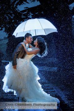 Rain with bride and groom - Hazlewood Castle www.chrischambersphotography.co.uk