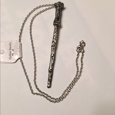 """Harry Potter Magic Wand necklace.  NWOT Chain is silver finish look and wand is pewter look finish.  Chain is 20"""" long and wand is 4-1/2""""long.   JW00159010416 Jewelry Necklaces"""
