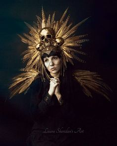 Photography: @sheridans_art Model: @lola.alesia Headdress/Epaulettes: @hysteriamachine This stunning design is available as made to order at www.etsy.com/shop/HysteriaMachine or follow the clickable link in my bio #handmade #queen #creative #photography #dark #darkbeauty #alternative #masqueradeball #fantasy #dressup #alternativefashion #gold #skull #skulls #skeleton #art #feathers