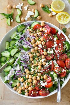 This cucumber salad is cool and crisp, loaded with delicious add-ins, and dressed simply with good olive oil, lemon juice, and sea salt! Cucumber Recipes, Cucumber Salad, Healthy Salad Recipes, Diet Recipes, Vegetarian Recipes, Cooking Recipes, Cherry Tomato Recipes, Chickpea Recipes, Tomato Salad