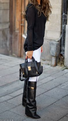 White jeans, black boots, long sleeve black blouse -