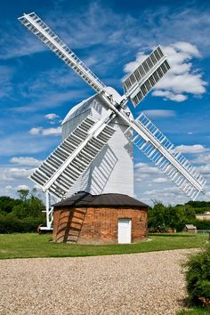 The windmill at Bardwell is a Tower Mill. It was powered by the wind and was used for making flour.  It has four storeys and a full top, plus sails.  The mill has been restored and is functioning today.  It produces its own flour and fresh home made bread can be bought.