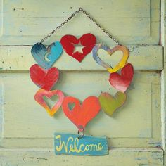 Welcome Hearts Wall Art: Greet guests and family with love. Made of steel hand cut by Patrick Henderson and handpainted by Jes MaHarry, each heart welcome sign is a unique work of art signed by the artists. Heart Day, I Love Heart, Happy Heart, Valentine Wreath, Valentine Gifts, Heart Wreath, Door Wreath, House On The Rock, Heart Sign