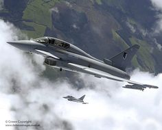 An aerial image of two Typhoon multi-role aircraft from 17 Sqn in flight above the clouds.