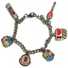 Chain bracelet sports six charms linking you to sweet treats you remember from your favorite candy stores and movie theaters.