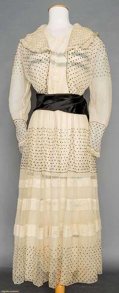 "BLACK DOTTED WHITE NET DRESS, N.Y., c. 1915  Armistice collar, white tucked net bodice, wide black silk satin sash, label ""Maison Maurice Paris, London, New York"""