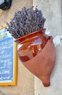 Here, dried lavender is stuck in a clay pot and hung outside a #café in Provence.  Charmant!  Lavande by Leah Marie Brown(CLICK TO READ ARTICLE)