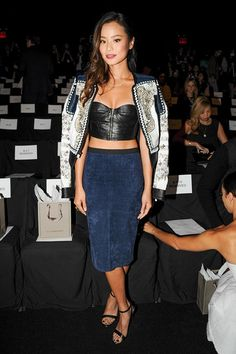Jamie Chung front row at BCBG SS Spring Summer 2014 Show New York Fashion Week NYFW Embellished Denim Jacket Over the Shoulders Leather Crop Bustier Top High Waist Denim Pencil Skirt Starppy Black Heels Sandals