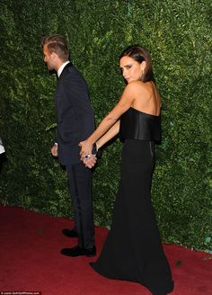 David Beckham holds wife Victoria's hand at the Evening Standard awards   Daily Mail Online