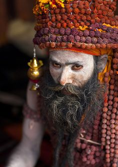 Sadhu With Rudraksha Mala, Maha Kumbh Mela, Allahabad, India by Eric Lafforgue, via Flickr