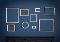 gold frames on a blue wall