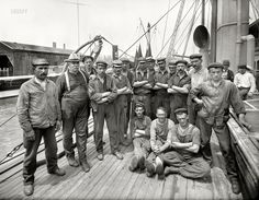 "New York, September 4, 1909. ""Crew of Peary arctic ship Roosevelt: First Mate Thomas Gushue (far left), Chief Engineer George A. Wardwell and the men."" The Roosevelt sailed in the Hudson-Fulton celebration shortly after this portrait was made. 8x10 glass negative, Bain News Service."