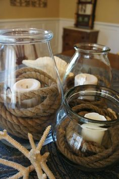 Centerpieces don't have to be complicated! All you need for this nautical centerpiece is rope, candles, and jars. Nautical Centerpiece, Summer Centerpieces, Table Centerpieces, Centerpiece Ideas, Nautical Bridal Showers, Nautical Party, Nautical Rope, Deco Table, Wedding Table
