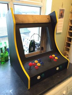 The 'Galactic Starcade' is a DIY retro bartop arcade cabinet for two players. It is powered by the Raspberry Pi micro-computer and plays multiple types of retro. Pi Arcade, Arcade Bartop, Arcade Room, Arcade Stick, Arcade Games, Arcade Cabinet Plans, Gaming Cabinet, Retro Pi, Raspberry Projects