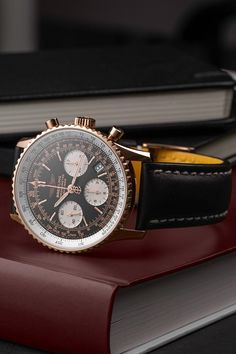 The Breitling Navitimer (Ref. R23322) adds a luxurious touch to the collection with its 18-carat rose gold case. Designed as a highly functional pilot's watch the Navitimer features a 30-metre water resistance, an automatic movement, a slide-rule bezel, a chronograph as well as a date window. This model is, thanks to its 41.8 mm case diameter, also comfortable to wear on slimmer wrists but appears significantly larger due to its gold and white bezel ring.