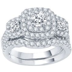 """This outstanding bridal set broadcasts beauty and romance. With 87 whitediamonds, it offers so much sparkle! And you'll be taken with the undersideof the engagement ring, where a single color-enhanced blue diamond, set between infinity symbols, resides to serve as your """"something blue. """" An adjoining, diamond-encrusted band completes this magnificent set. Metal: Rhodium-plated 14K white gold Stones: 2 ct. t. w. round, white diamonds, including a 1/2 ct. center stone Stone: Color-enhanced…"""